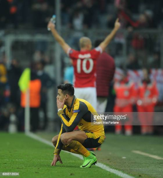 Dejected Arsenal striker Alexis Sanchez as Arjen Robben celebrates the 5th Bayern Munich goal during the UEFA Champions League Round of 16 first leg...