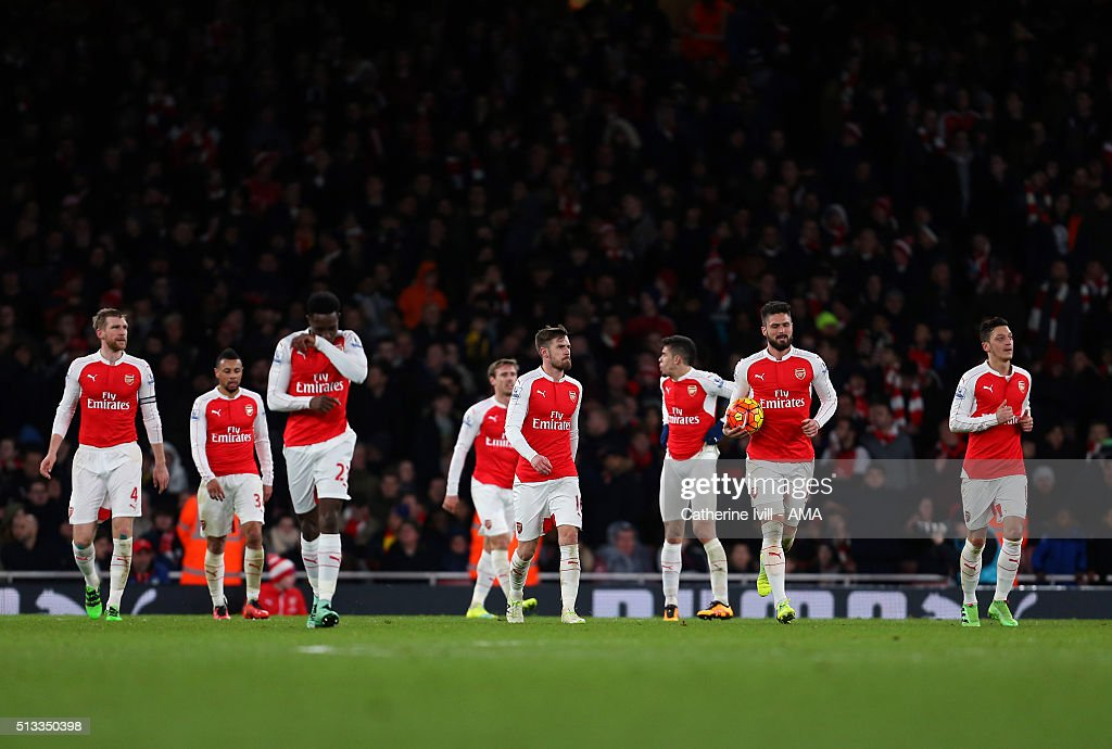 A dejected Arsenal team after Swansea City score to make it 1-2 during the Barclays Premier League match between Arsenal and Swansea City at the Emirates Stadium on March 02, 2016 in London, England.