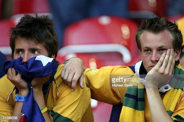 Dejected Australian fans look on following their team's 10 defeat and exit from the competition during the FIFA World Cup Germany 2006 Round of 16...
