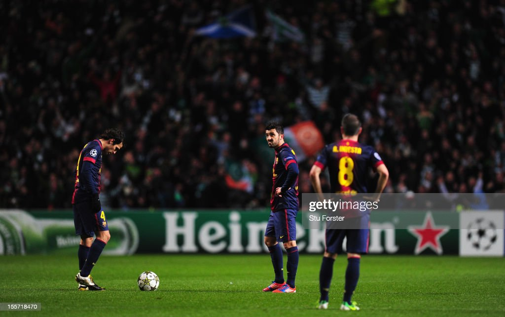 Dejected Barcelona players wait to kick off after Celtic had scored their second goal during the UEFA Champions League Group G match between Celtic and Barcelona at Celtic Park on November 7, 2012 in Glasgow, Scotland.