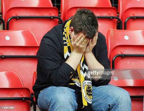 A dejected Boston United fan reacts to being knocked out of the football league during CocaCola Football League Two game between Wrexham and Boston...