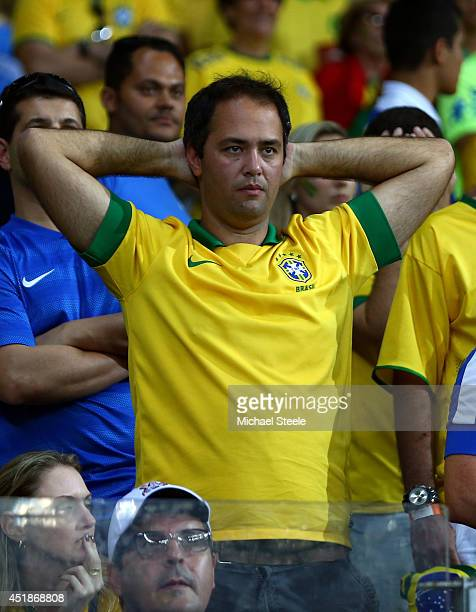 A dejected Brazil fan looks on during the 2014 FIFA World Cup Brazil Semi Final match between Brazil and Germany at Estadio Mineirao on July 8 2014...