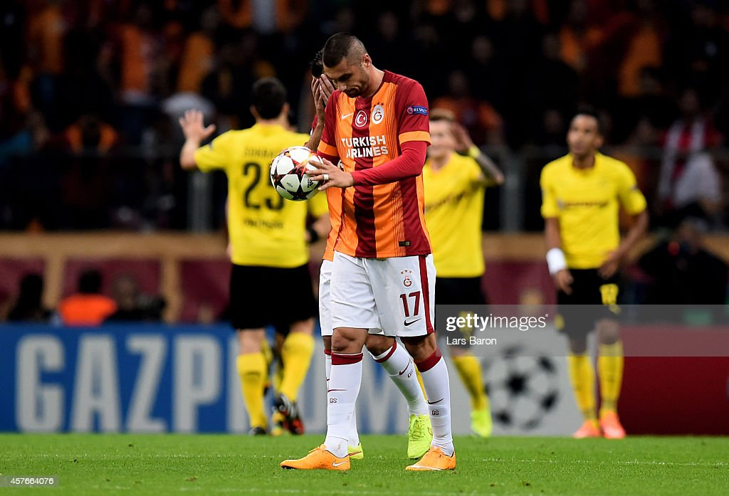 A dejected <a gi-track='captionPersonalityLinkClicked' href=/galleries/search?phrase=Burak+Yilmaz&family=editorial&specificpeople=8254293 ng-click='$event.stopPropagation()'>Burak Yilmaz</a> of Galatasaray reacts after his team concede a second goal during UEFA Champions League Group D match between Galatasaray and Borussia Dortmund at Turk Telekom Arena on October 22, 2014 in Istanbul, Turkey.