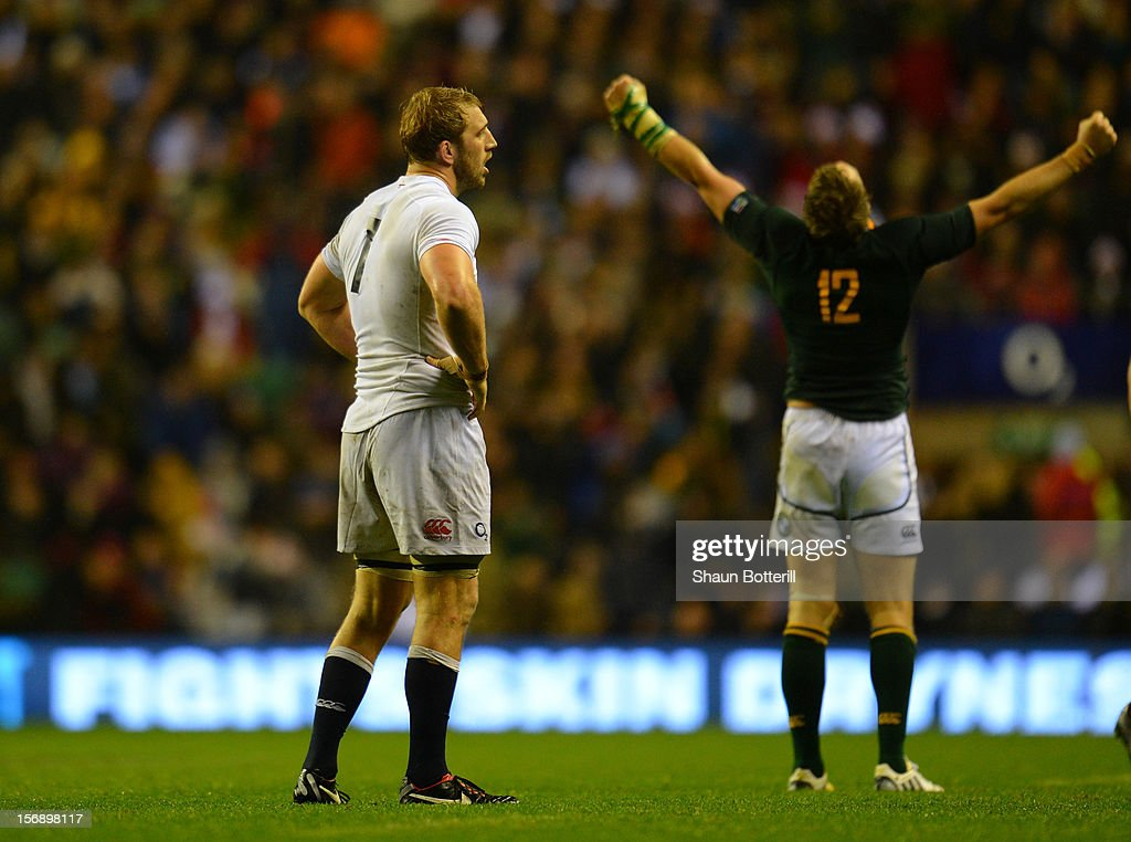 Dejected captain <a gi-track='captionPersonalityLinkClicked' href=/galleries/search?phrase=Chris+Robshaw&family=editorial&specificpeople=2375303 ng-click='$event.stopPropagation()'>Chris Robshaw</a> of England looks on after their defeat during the QBE International match between England and South Africa at Twickenham Stadium on November 24, 2012 in London, England.