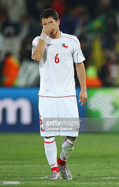 Dejected Carlos Carmona of Chile after being knocked out of the tournament in the 2010 FIFA World Cup South Africa Round of Sixteen match between...