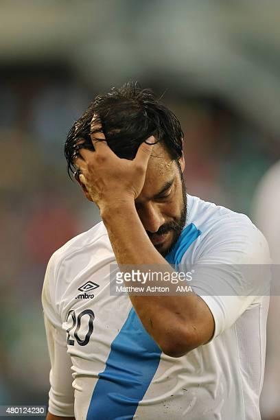 A dejected Carlos Ruiz of Guatemala walks off at the end of the game after losing 31 during the CONCACAF Gold Cup match between Trinidad Tobago and...
