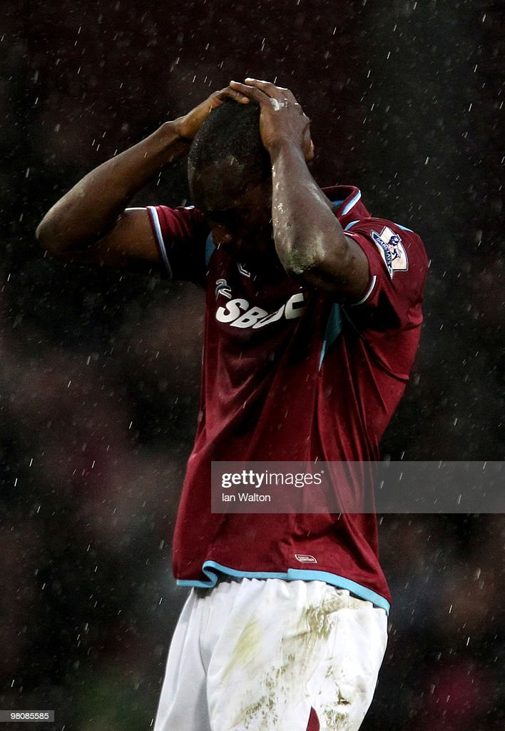 A dejected <a gi-track='captionPersonalityLinkClicked' href=/galleries/search?phrase=Carlton+Cole&family=editorial&specificpeople=215313 ng-click='$event.stopPropagation()'>Carlton Cole</a> of West Ham reacts after his team lose 1-0 during the Barclays Premier League match between West Ham United and Stoke City at the Boleyn Ground on March 27, 2010 in London, England.