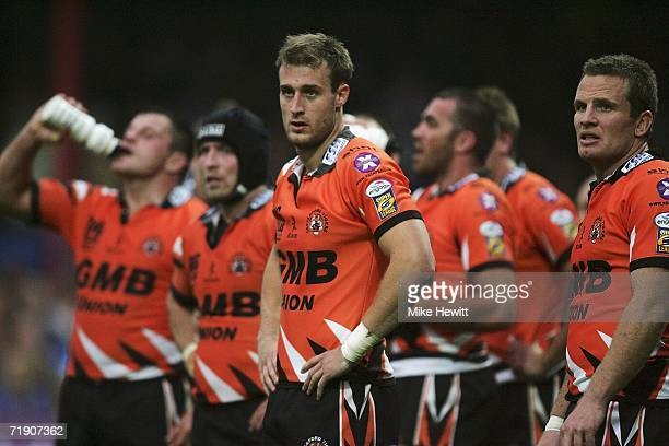 Dejected Castleford players look on as their team head to defeat and relegation from the Superleague during the Superleague match between Wakefield...
