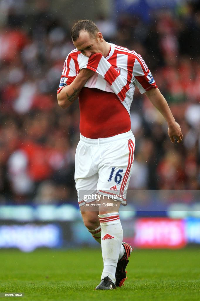 A dejected <a gi-track='captionPersonalityLinkClicked' href=/galleries/search?phrase=Charlie+Adam&family=editorial&specificpeople=3987843 ng-click='$event.stopPropagation()'>Charlie Adam</a> of Stoke walks off the pitch after being shown the red card by referee Kevin Friend following his second bookable offence during the Barclays Premier League match between Stoke City and Tottenham Hotspur at Britannia Stadium on May 12, 2013 in Stoke on Trent, England.