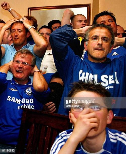 Dejected Chelsea fans react as Manchester United win the UEFA Champions League Final between Manchester United FC and Chelsea FC after penalties in...