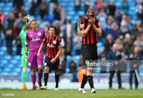 A dejected Clint Hill of QPR and teammates react following their team's relegation during the Barclays Premier League match between Manchester City...