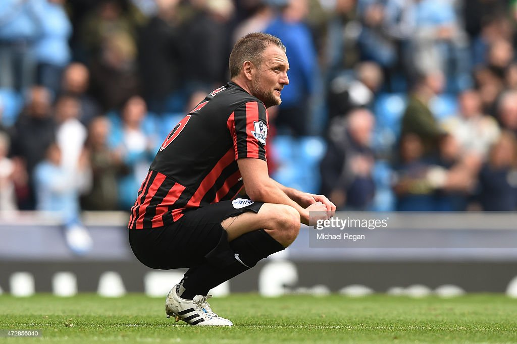 A dejected Clint Hill of QPR reacts following his team's relegation during the Barclays Premier League match between Manchester City and Queens Park Rangers at the Etihad Stadium on May 10, 2015 in Manchester, England.