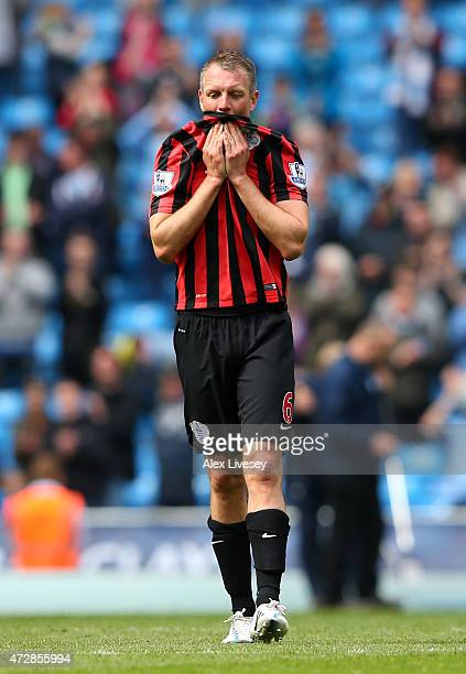 A dejected Clint Hillof QPR reacts following his team's relegation during the Barclays Premier League match between Manchester City and Queens Park...