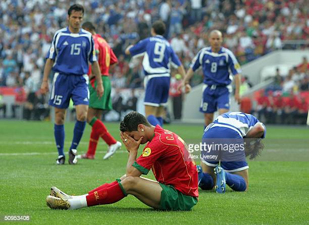 A dejected Cristiano Ronaldo of Portugal after bringing down Georgios Seitardis of Greece to give a penalty during the Portugal v Greece Group A...