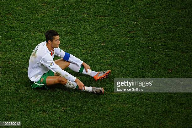 Dejected Cristiano Ronaldo of Portugal after his side is knocked out of the tournament during the 2010 FIFA World Cup South Africa Round of Sixteen...