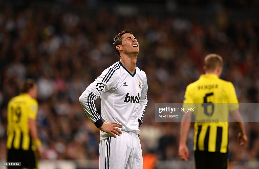 A dejected <a gi-track='captionPersonalityLinkClicked' href=/galleries/search?phrase=Cristiano+Ronaldo+-+Soccer+Player&family=editorial&specificpeople=162689 ng-click='$event.stopPropagation()'>Cristiano Ronaldo</a> of Real Madrid during the UEFA Champions League Semi Final Second Leg match between Real Madrid and Borussia Dortmund at Estadio Santiago Bernabeu on April 30, 2013 in Madrid, Spain.