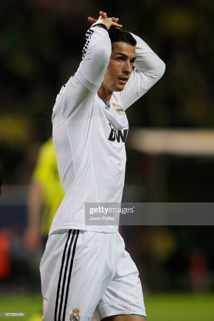 A dejected <a gi-track='captionPersonalityLinkClicked' href=/galleries/search?phrase=Cristiano+Ronaldo&family=editorial&specificpeople=162689 ng-click='$event.stopPropagation()'>Cristiano Ronaldo</a> of Real Madrid looks on during the UEFA Champions League semi final first leg match between Borussia Dortmund and Real Madrid at Signal Iduna Park on April 24, 2013 in Dortmund, Germany.