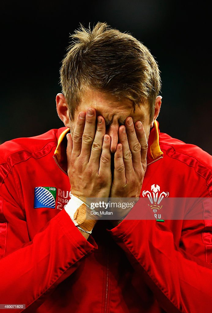 A dejected Dan Biggar of Wales holds his head in his hands following defeat in the 2015 Rugby World Cup Quarter Final match between South Africa and...