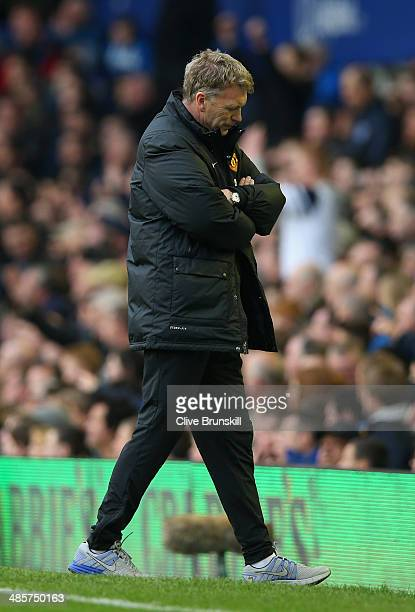 A dejected David Moyes manager of Manchester United looks to the ground during the Barclays Premier League match between Everton and Manchester...