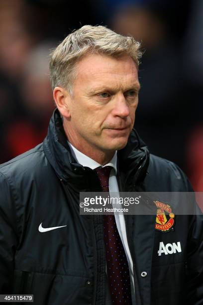 A dejected David Moyes the Manchester United manager walks off the pitch following his team's 10 defeat during the Barclays Premier League match...