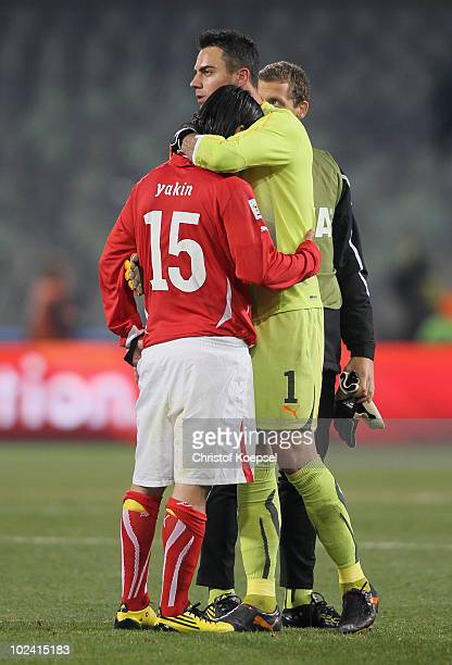 Dejected Diego Benaglio of Switzerland consoles team mate Hakan Yakin after a goalless draw and elimination from the tournament during the 2010 FIFA...