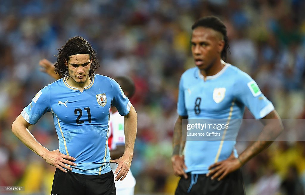 A dejected <a gi-track='captionPersonalityLinkClicked' href=/galleries/search?phrase=Edinson+Cavani&family=editorial&specificpeople=4104253 ng-click='$event.stopPropagation()'>Edinson Cavani</a> of Uruguay looks down during the 2014 FIFA World Cup Brazil Group D match between Uruguay and Costa Rica at Castelao on June 14, 2014 in Fortaleza, Brazil.