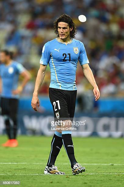 A dejected Edinson Cavani of Uruguay looks down during the 2014 FIFA World Cup Brazil Group D match between Uruguay and Costa Rica at Castelao on...
