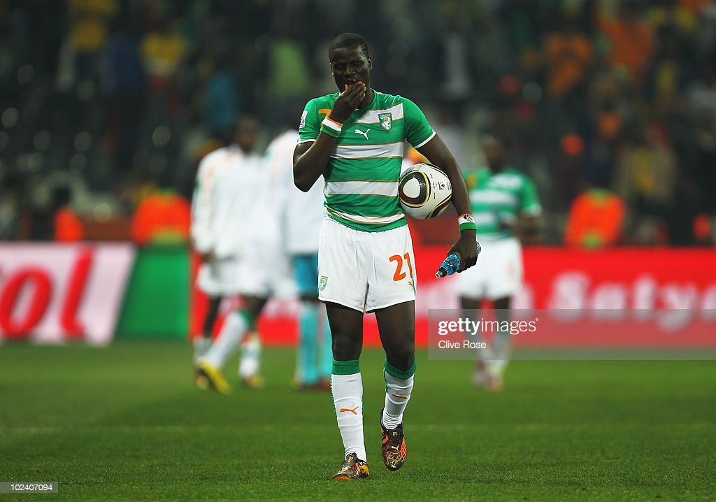 Dejected <a gi-track='captionPersonalityLinkClicked' href=/galleries/search?phrase=Emmanuel+Eboue&family=editorial&specificpeople=564874 ng-click='$event.stopPropagation()'>Emmanuel Eboue</a> of the Ivory Coast after victory in the game but elimination from the tournament during the 2010 FIFA World Cup South Africa Group G match between North Korea and Ivory Coast at the Mbombela Stadium on June 25, 2010 in Nelspruit, South Africa.