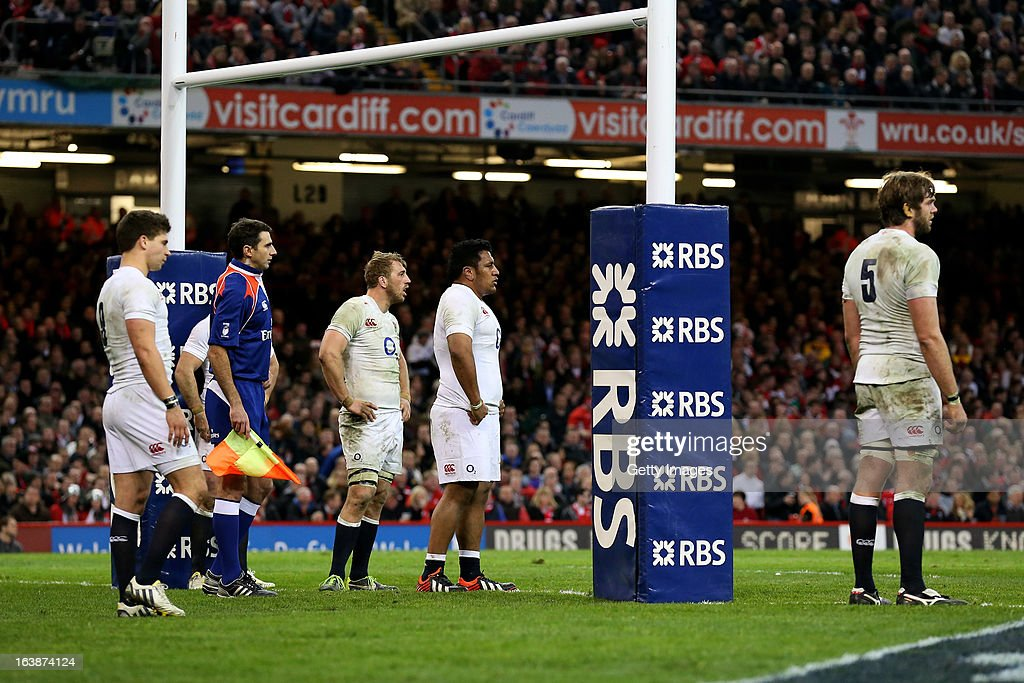 Dejected England players look on during the RBS Six Nations match between Wales and England at Millennium Stadium on March 16, 2013 in Cardiff, Wales.