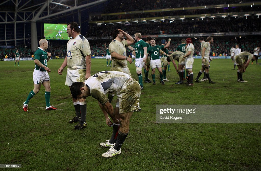 Dejected England players react following their team's defeat during the RBS 6 Nations Championship match between Ireland and England at the Aviva Stadium on March 19, 2011 in Dublin, Ireland.