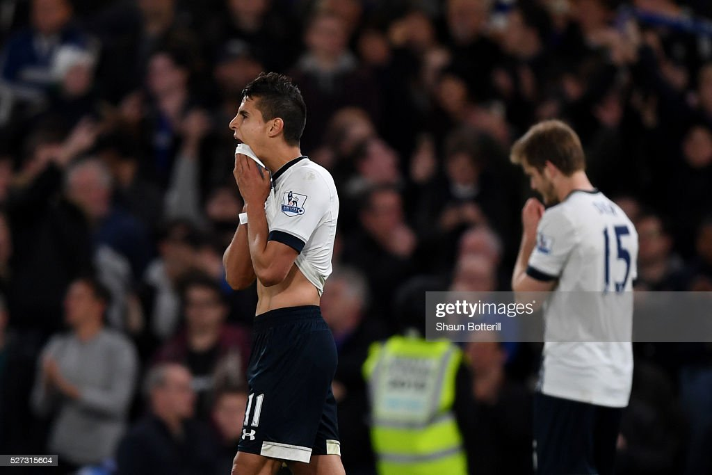 A dejected <a gi-track='captionPersonalityLinkClicked' href=/galleries/search?phrase=Erik+Lamela&family=editorial&specificpeople=7198648 ng-click='$event.stopPropagation()'>Erik Lamela</a> of Tottenham Hotspur walks off the pitch following the 2-2 draw during the Barclays Premier League match between Chelsea and Tottenham Hotspur at Stamford Bridge on May 02, 2016 in London, England.jd