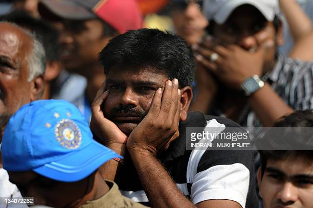 A dejected fan reacts after Indian batsman Sachin Tendulkar was dismissed for 94 runs during the fourth day's play of the third Test cricket match...
