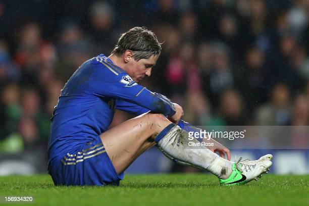 A dejected Fernando Torres of Chelsea looks on during the Barclays Premier League match between Chelsea and Manchester City at Stamford Bridge on...