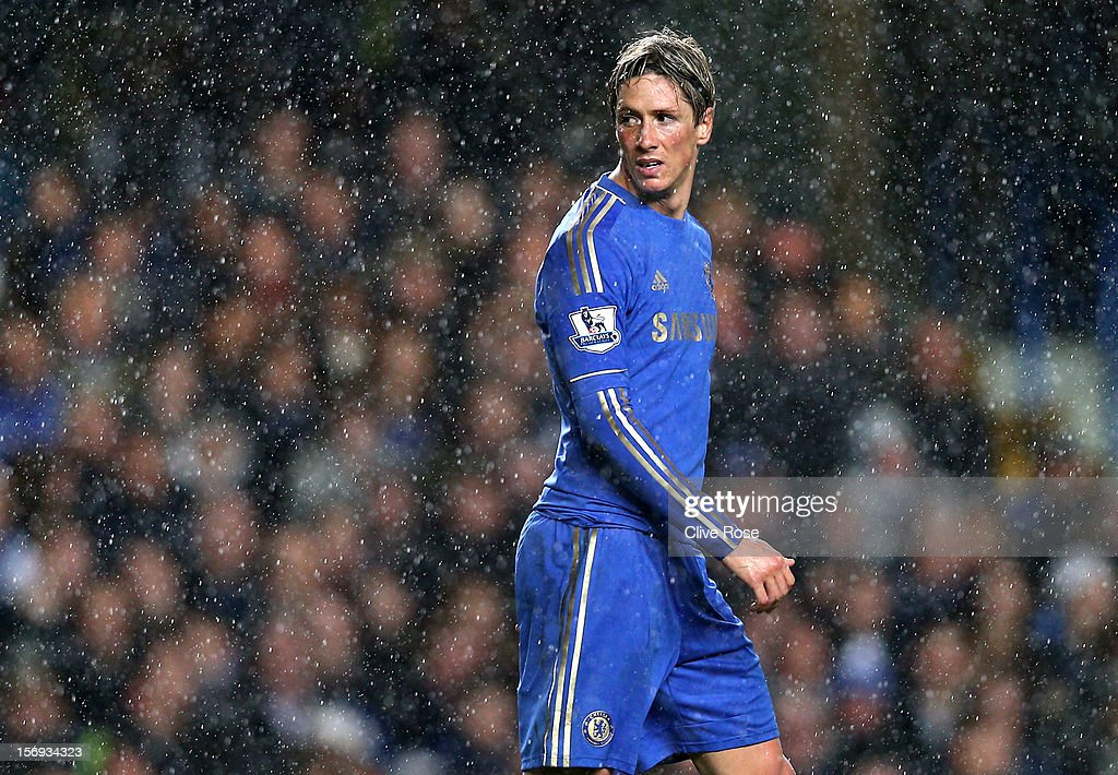 A dejected <a gi-track='captionPersonalityLinkClicked' href=/galleries/search?phrase=Fernando+Torres&family=editorial&specificpeople=194755 ng-click='$event.stopPropagation()'>Fernando Torres</a> of Chelsea looks on during the Barclays Premier League match between Chelsea and Manchester City at Stamford Bridge on November 25, 2012 in London, England.