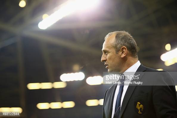 A dejected France head coach Philippe SaintAndre leaves the field afterdefeat in the 2015 Rugby World Cup Quarter Final match between New Zealand and...