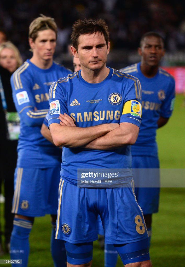 A dejected <a gi-track='captionPersonalityLinkClicked' href=/galleries/search?phrase=Frank+Lampard+-+Born+1978&family=editorial&specificpeople=11497645 ng-click='$event.stopPropagation()'>Frank Lampard</a> of Chelsea with team mates <a gi-track='captionPersonalityLinkClicked' href=/galleries/search?phrase=Fernando+Torres&family=editorial&specificpeople=194755 ng-click='$event.stopPropagation()'>Fernando Torres</a> and Ramires wait for the awards ceremony after the FIFA Club World Cup Final Match between Corinthians and Chelsea at International Stadium Yokohama on December 16, 2012 in Yokohama, Japan.