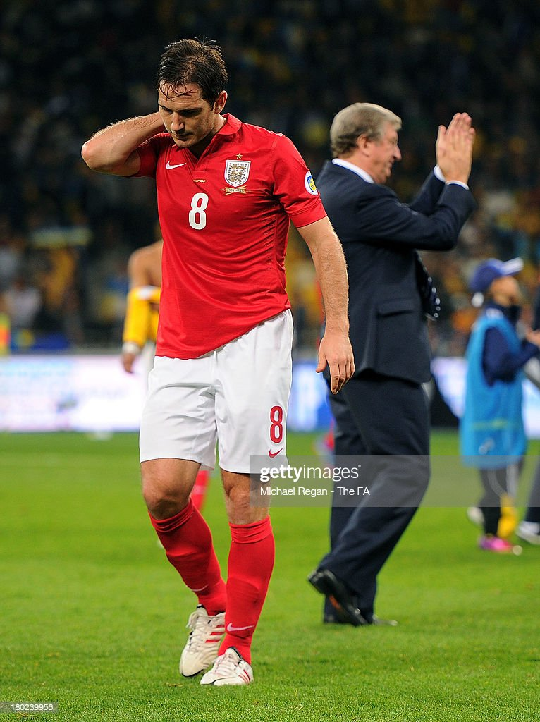 A dejected <a gi-track='captionPersonalityLinkClicked' href=/galleries/search?phrase=Frank+Lampard+-+Born+1978&family=editorial&specificpeople=11497645 ng-click='$event.stopPropagation()'>Frank Lampard</a> of England walks off the pitch whilst <a gi-track='captionPersonalityLinkClicked' href=/galleries/search?phrase=Roy+Hodgson&family=editorial&specificpeople=881703 ng-click='$event.stopPropagation()'>Roy Hodgson</a> the England manager applauds the travelling fans following the 0-0 draw during the FIFA 2014 World Cup Qualifying Group H match between Ukraine and England at the Olympic Stadium on September 10, 2013 in Kiev, Ukraine.