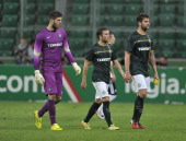 A dejected Fraser Forster Adam Matthews and Charlie Mulgrew of Celtic leave the pitch after the third qualifying round UEFA Champions League match...