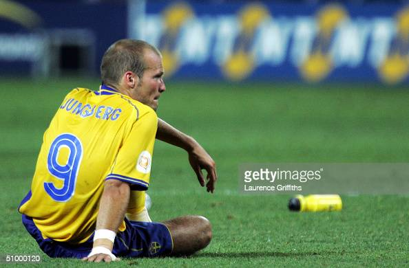 A dejected Fredrik Ljungberg of Sweden sits after Sweden lost on penaltys during the UEFA Euro 2004 Quarter Final match between Sweden and Holland at...