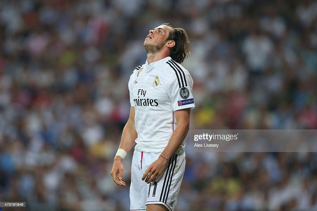 A dejected <a gi-track='captionPersonalityLinkClicked' href=/galleries/search?phrase=Gareth+Bale&family=editorial&specificpeople=609290 ng-click='$event.stopPropagation()'>Gareth Bale</a> of Real Madrid reacts following his team's exit from the competition during the UEFA Champions League Semi Final, second leg match between Real Madrid and Juventus at Estadio Santiago Bernabeu on May 13, 2015 in Madrid, Spain.