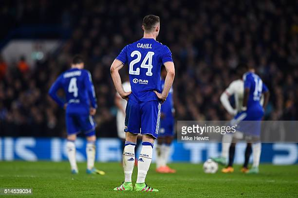 A dejected Gary Cahill of Chelsea and teammates look on during the UEFA Champions League round of 16 second leg match between Chelsea and Paris Saint...