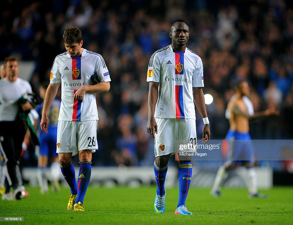 Dejected Gaston Sauro and Mohamed Elneny of Basel walk off the pitch following their team's 3-1 defeat during UEFA Europa League semi final second leg match between Chelsea and FC Basel 1893 at Stamford Bridge on May 2, 2013 in London, England.