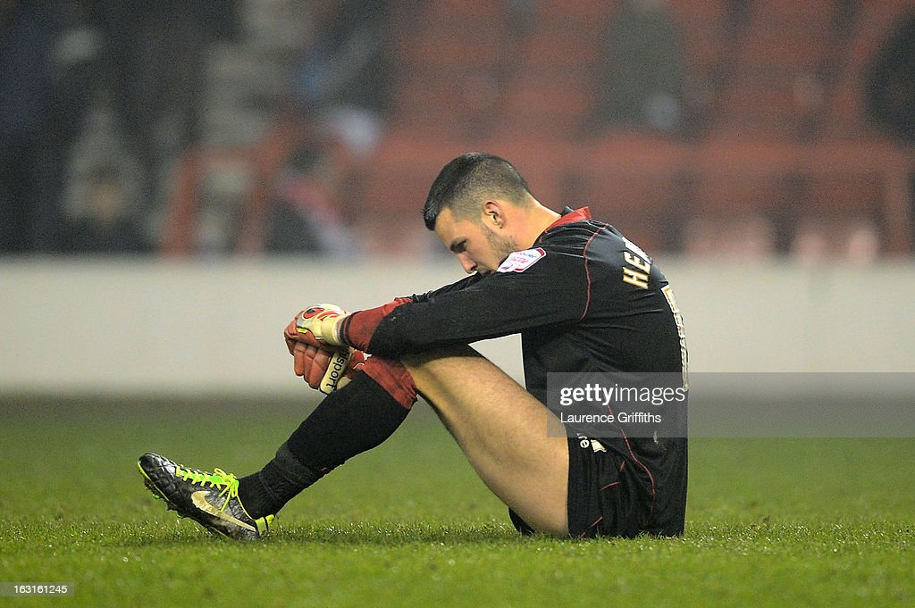 Dejected goalkeepe rStephen Henderson of Ipswich sits on the pitch following his team's defeat during the npower Championship match between Nottingham Forest and Ipswich Town at City Ground on March 5, 2013 in Nottingham, England.