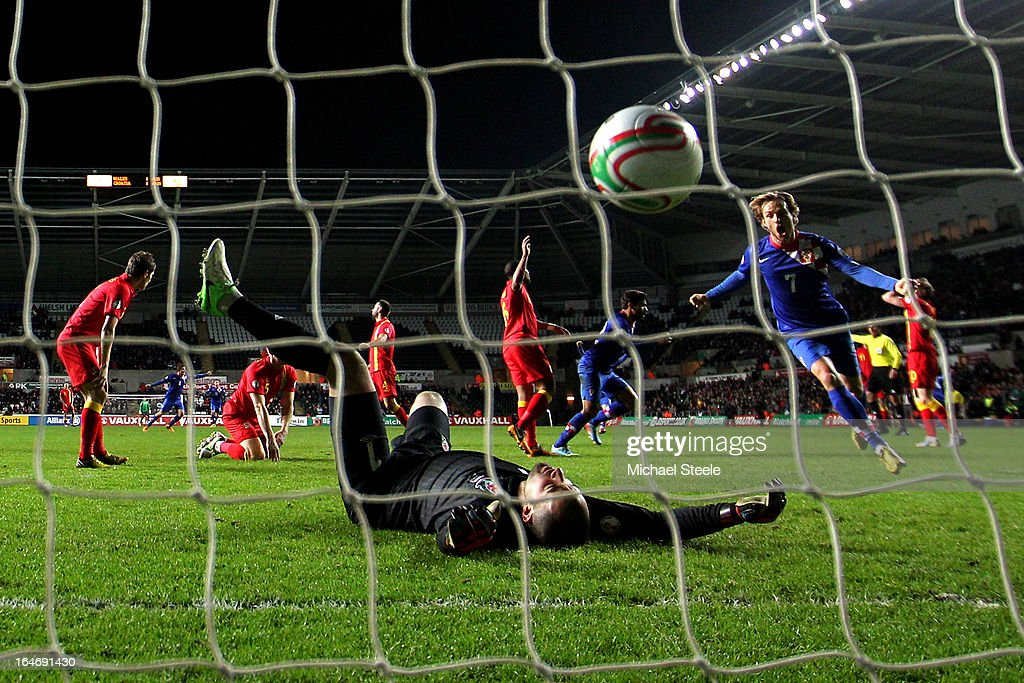 Dejected goalkeeper Boaz Myhill of Wales lies on the ground after Eduardo of Croatia scores his team's second and match winning goal during the FIFA 2014 World Cup qualifier between Wales and Croatia at The Liberty Stadium on March 26, 2013 in Swansea, Wales.