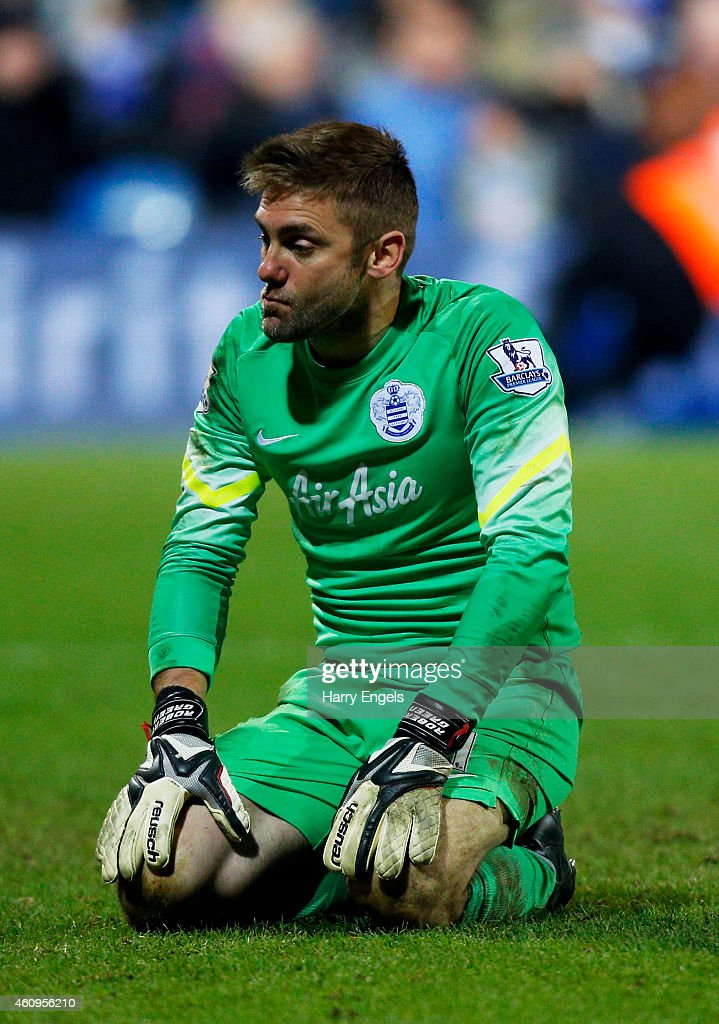 Dejected goalkeeper Robert Green of QPR reacts after conceding an injury time goal to level the scores at 1-1 during the Barclays Premier League match between Queens Park Rangers and Swansea City at Loftus Road on January 1, 2015 in London, England.