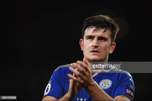 A dejected Harry Maguire of Leicester City applauds the travelling fans following their team's 43 defeat during the Premier League match between...