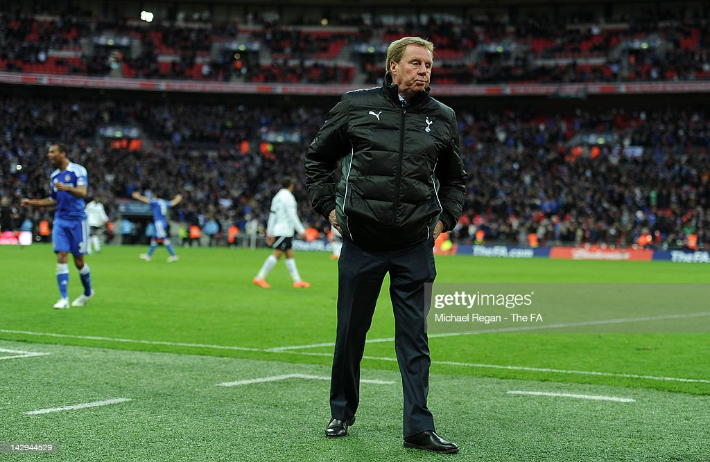 Dejected <a gi-track='captionPersonalityLinkClicked' href=/galleries/search?phrase=Harry+Redknapp&family=editorial&specificpeople=204768 ng-click='$event.stopPropagation()'>Harry Redknapp</a> of Tottenham Hotspur after defeat in the FA Cup with Budweiser Semi Final match between Tottenham Hotspur and Chelsea at Wembley Stadium on April 15, 2012 in London, England.
