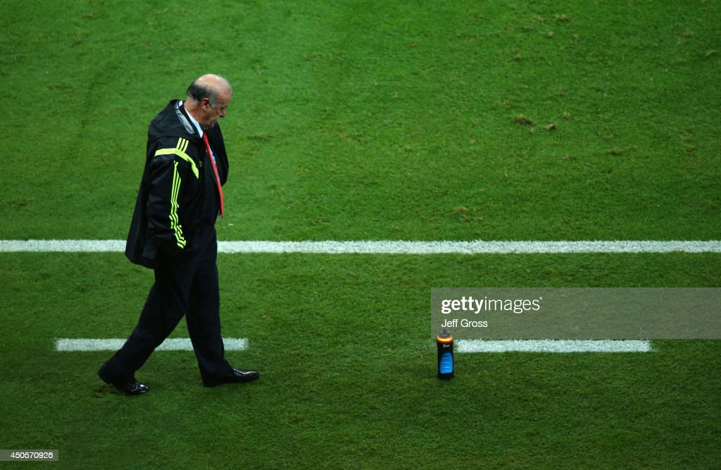 A dejected head coach <a gi-track='captionPersonalityLinkClicked' href=/galleries/search?phrase=Vicente+del+Bosque&family=editorial&specificpeople=2400668 ng-click='$event.stopPropagation()'>Vicente del Bosque</a> of Spain looks on during the 2014 FIFA World Cup Brazil Group B match between Spain and Netherlands at Arena Fonte Nova on June 13, 2014 in Salvador, Brazil.