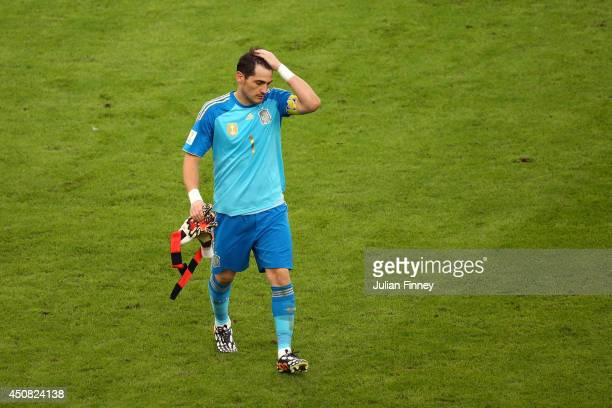 A dejected Iker Casillas of Spain walks off the field at the half during the 2014 FIFA World Cup Brazil Group B match between Spain and Chile at...