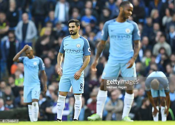 A dejected Ilkay Gundogan of Manchester City and teammates reacts after conceding the opening during the Premier League match between Manchester City...